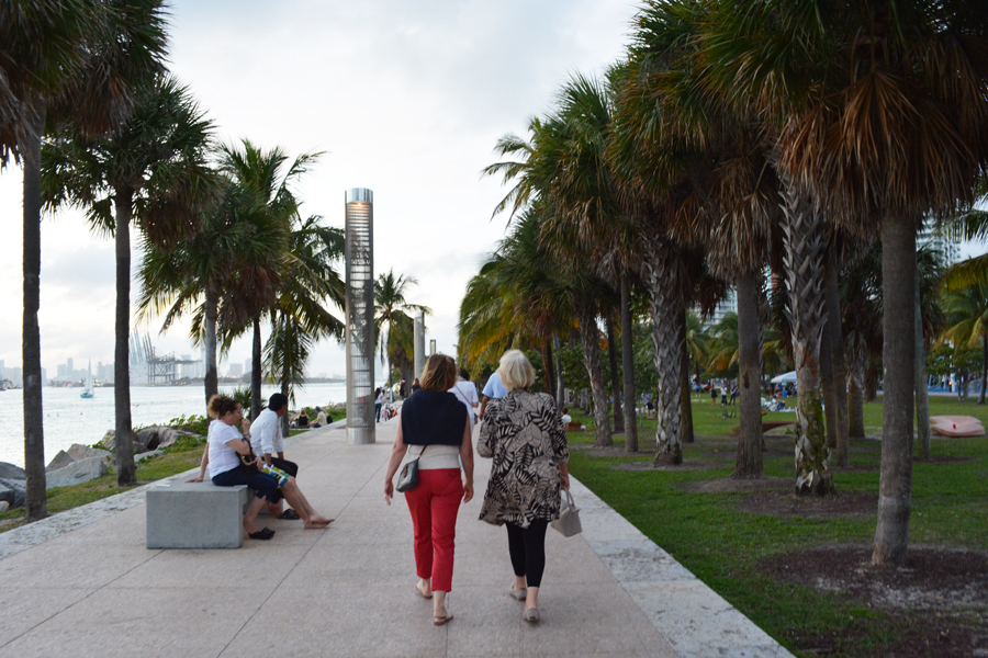 Visitors enjoy the walk along the water at South Pointe Park on Miami Beach.