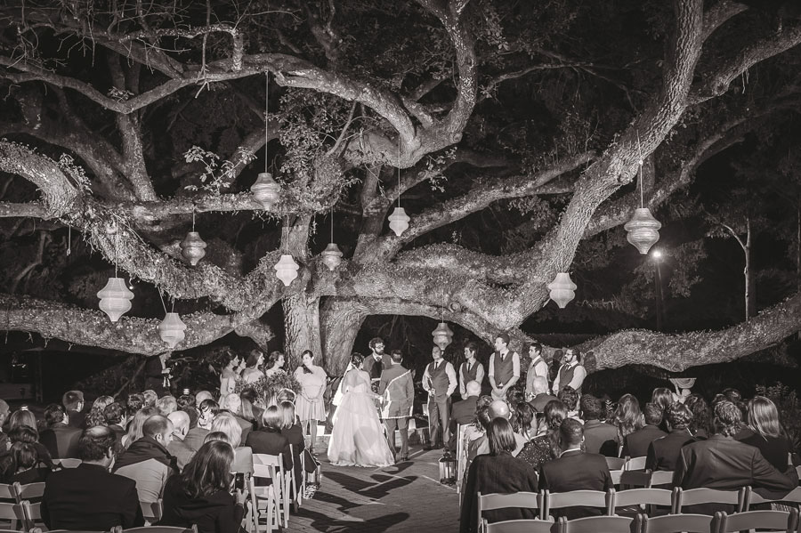 Meredith Lambert and Kevin Banogon get married in an outdoor wedding ceremony under a large oak tree at Vintage Court in Covington, Louisiana.