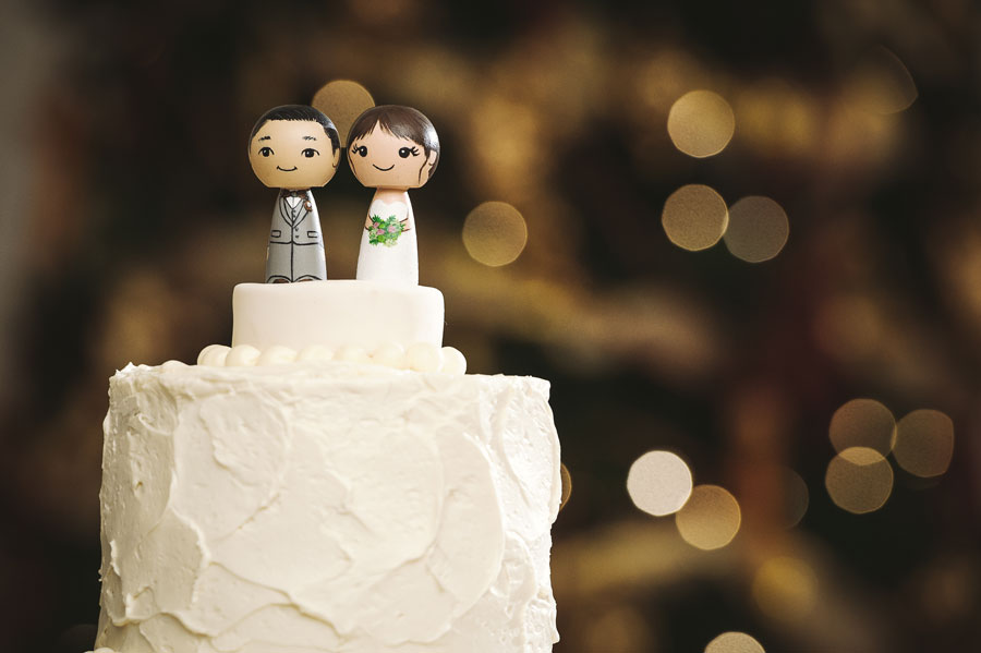 Custom wedding cake toppers hand painted to resemble the bride and groom on their wedding day.