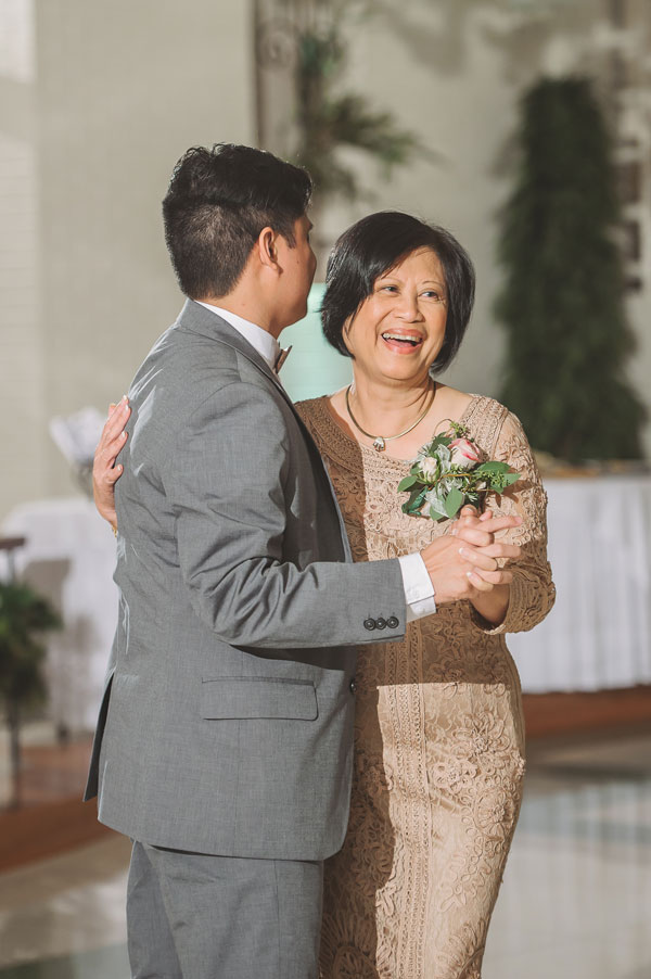 Kevin Banogon dances with his mother during his wedding at Vintage Court in Covington, Louisiana.