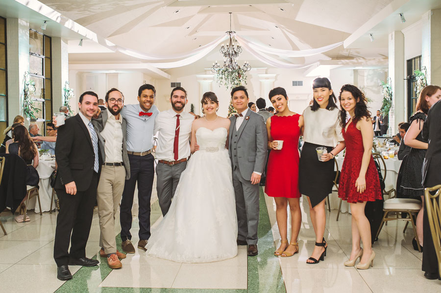Meredith Lambert and Kevin Banogon pose with a group of close college friends during their wedding reception at Vintage Court.