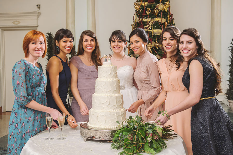 Meredith Lambert poses with the girls taking part in the New Orleans wedding tradition of cake pulls.