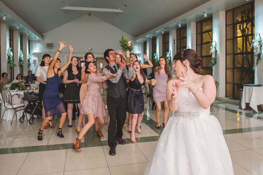 Guests scramble to catch the bouquet at a wedding at Vintage Court in Covington, LA.