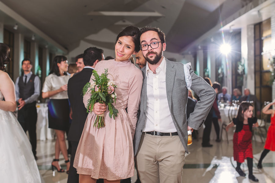 Alicia Doroteo catches the bridal bouquet and Alejandro Stein catches the garter at this Vintage Court wedding.