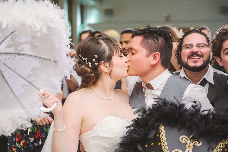 Meredith Lambert and Kevin Banogon end their wedding reception at Vintage Court with a kiss.