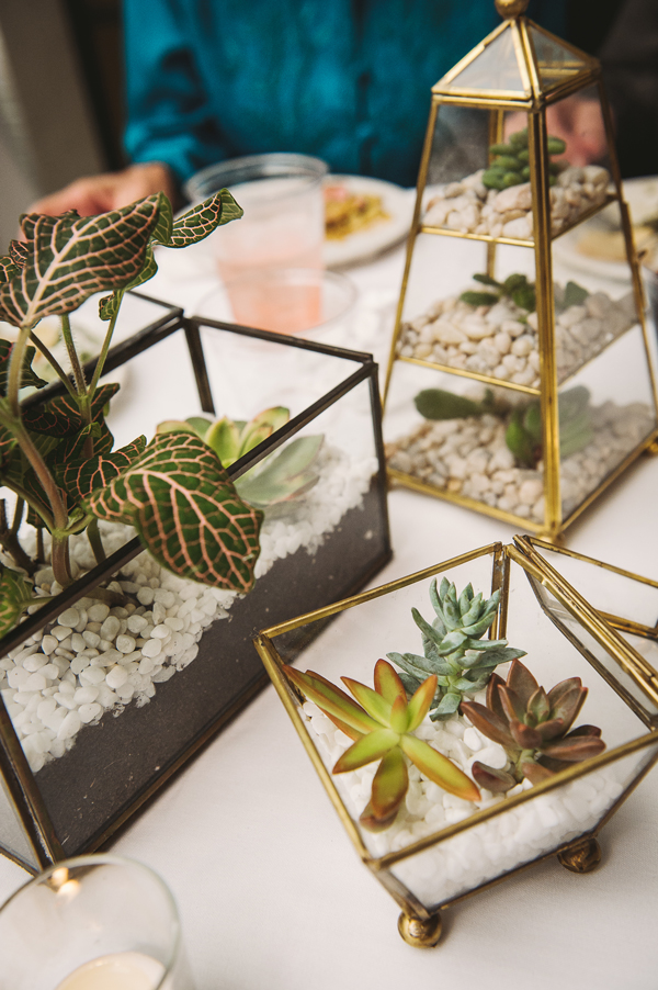 Homemade terrarium centerpieces at a wedding at Vintage Court.