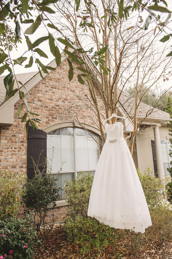 Meredith Lambert's wedding dress hung from a tree at her aunt's house in Covington, Louisiana.