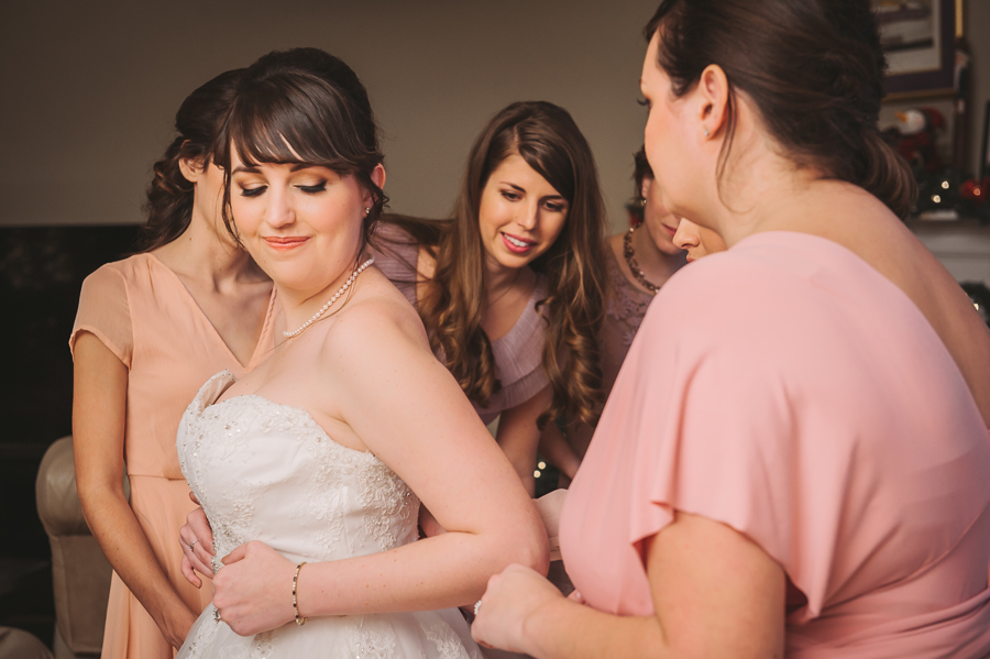 Wedding photographer captures a calm moment between the bride and her bridesmaids.