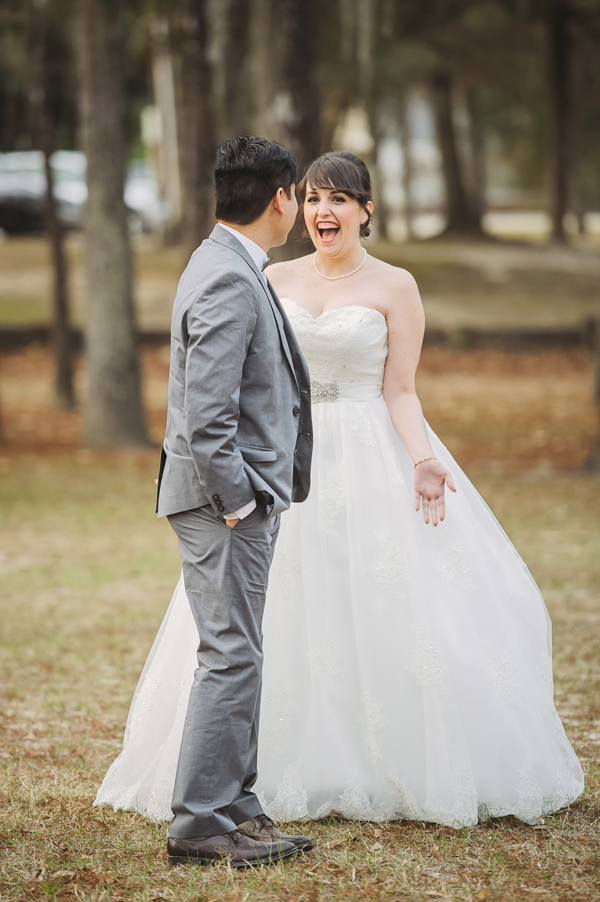 Wedding photographers capture the first look moment in Bogue Falaya Park in Covington.