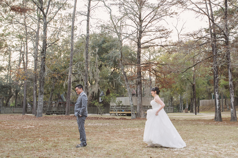 Wedding photographers capture the moment leading up to the first look in the Bogue Falaya Park in Covington.