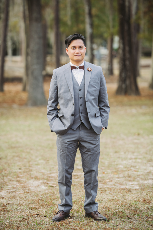 Kevin Banogon poses for the wedding photographer as a groom in the Bogue Falaya Park in Covington, Louisiana.