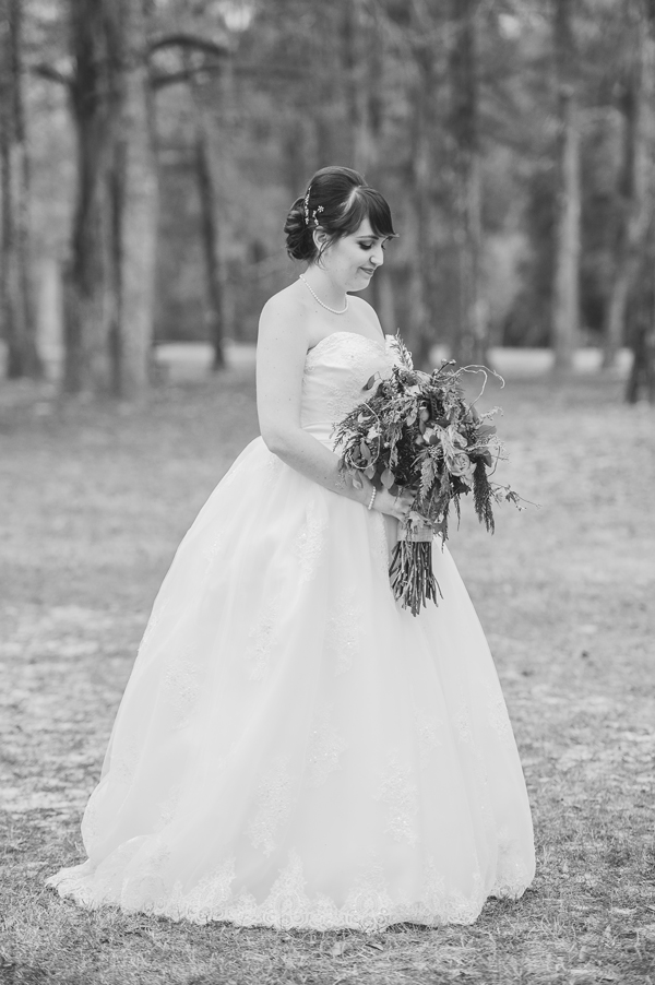 Meredith Lambert poses for the wedding photographer for bridal portraits in the Bogue Falaya Park in Covington.