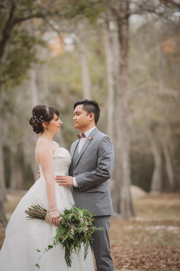 A tender moment captured by the wedding photographer in the Bogue Falaya Park in Covington.
