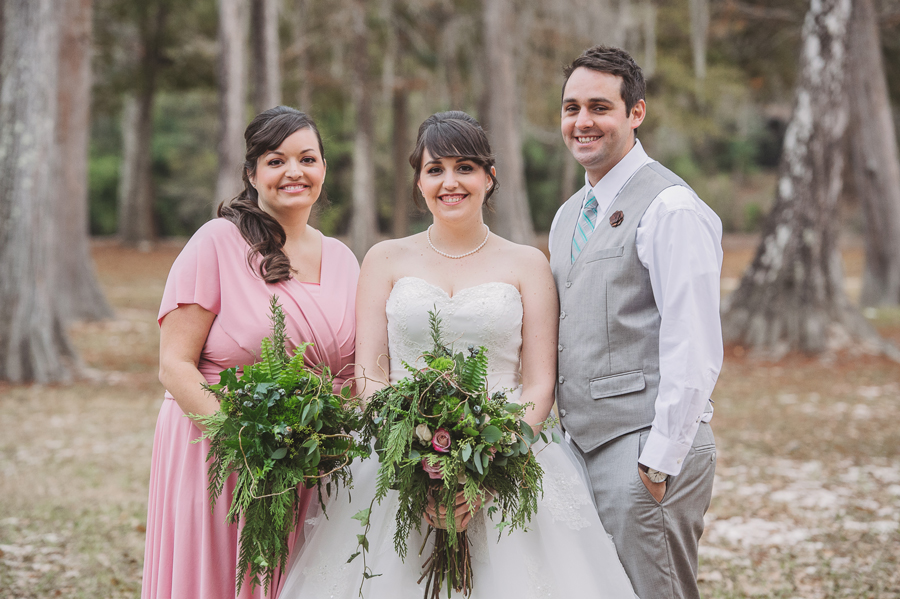 Covington wedding photographer captures the bride with her brother and sister in the Bogue Falaya Park in Covington.