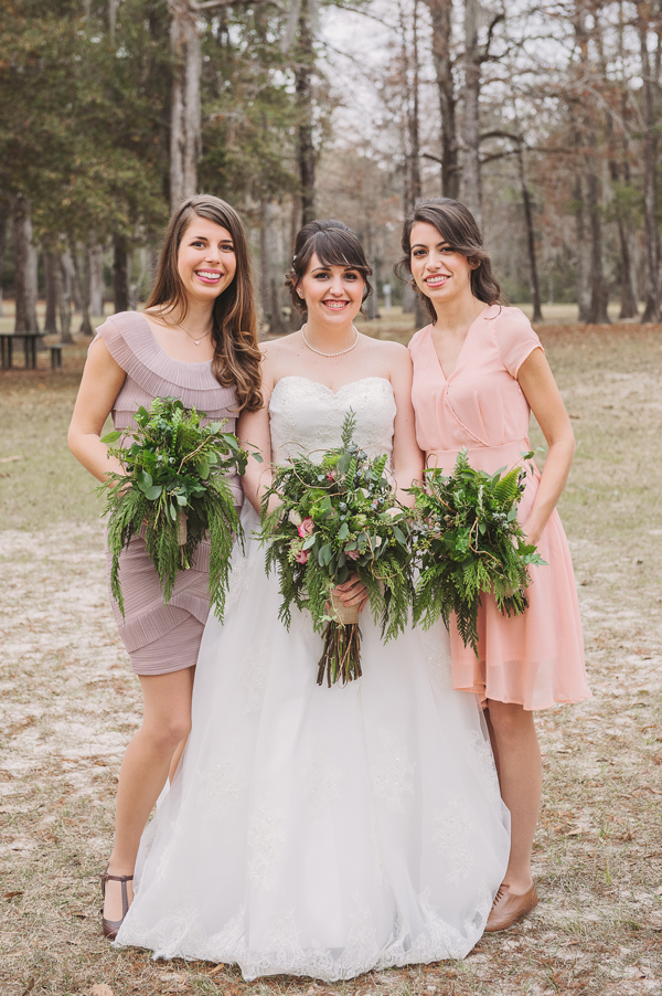 The bride poses with two childhood friends for the wedding formals taken at the Bogue Falaya Park in Covington.