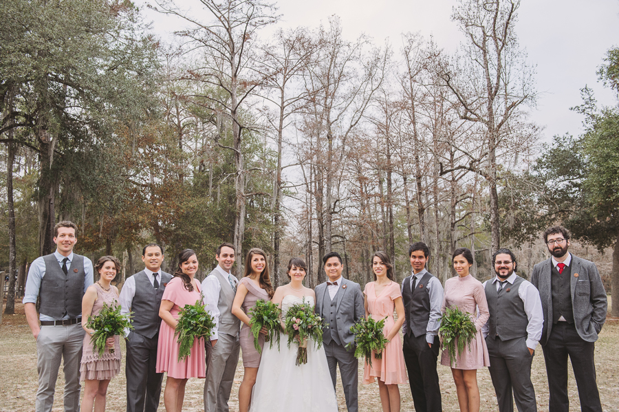 Wedding photography captures the entire wedding party formals in Bogue Falaya Park in Covington.