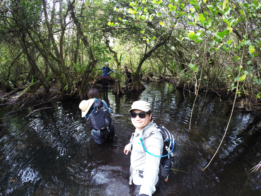 Kevin Banogon and Meredith Lambert Banogon hike through higher water in Big Cypress National Preserve.