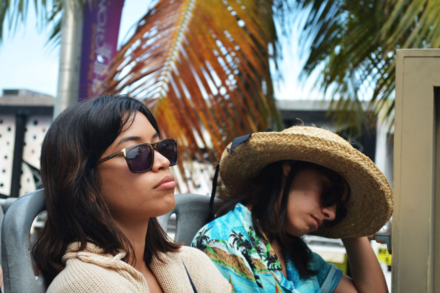 Alicia Doroteo and Jessica Estrada are tired from a long day riding the Big Bus Miami to say good bye to Miami.