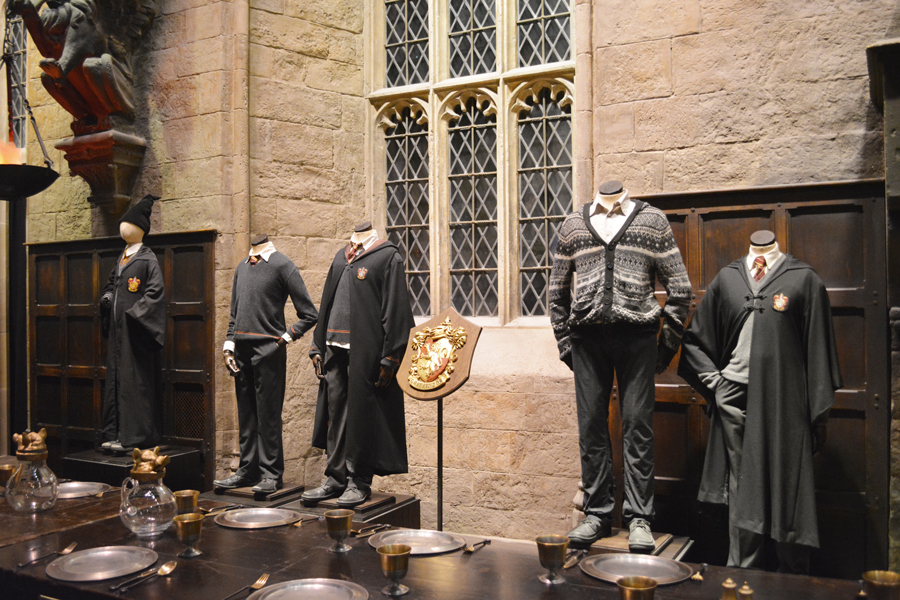 Gryffindor uniforms for Hogwarts School of Witchcraft and Wizardry on display at the Harry Potter Studio Tour in London.