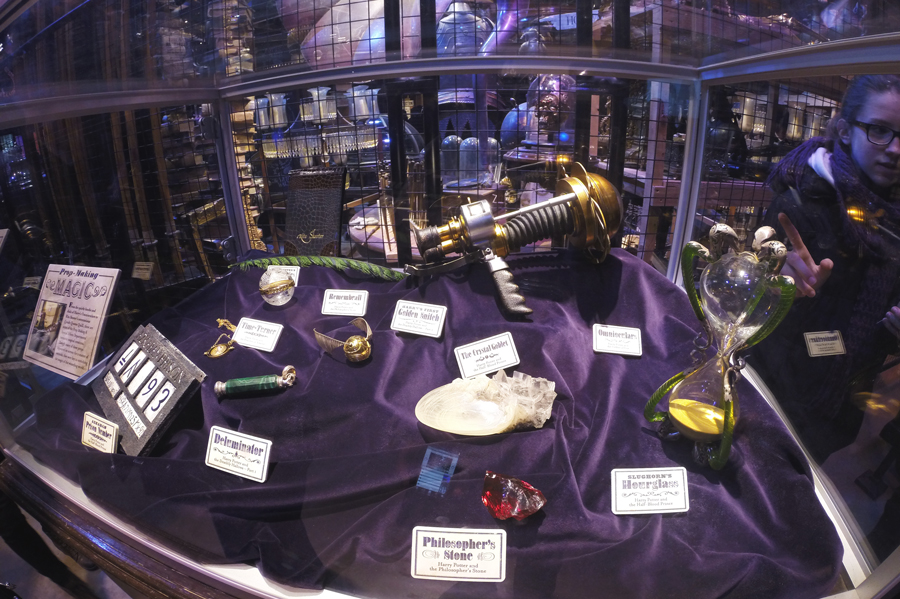 Smaller, detailed props used throughout the Harry Potter movies including the Remembrall, Deluminator, Snitch, and Time Turner.