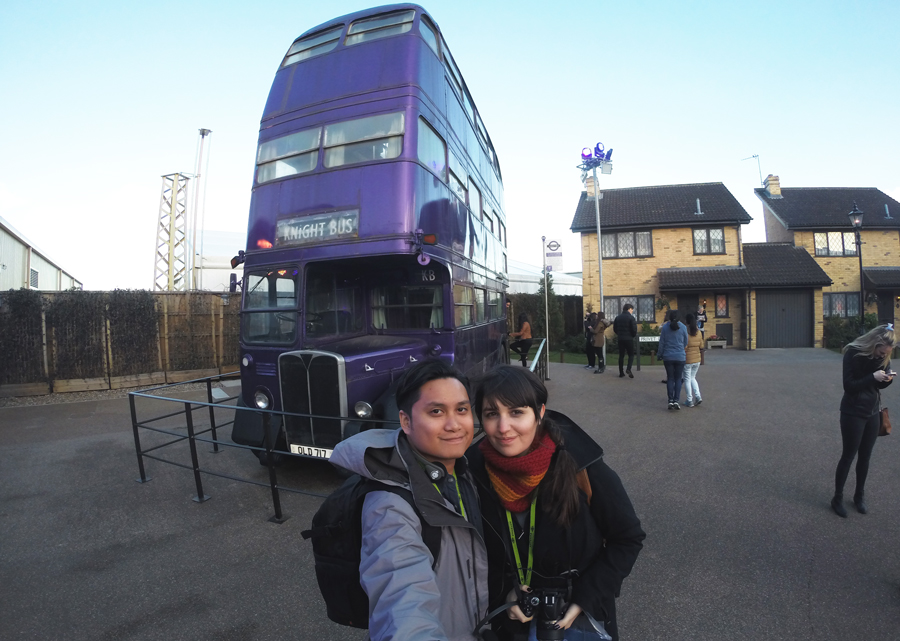 Kevin Banogon and Meredith Lambert Banogon pose in front of the Knight Bus on their honeymoon trip to the Harry Potter studio tour in London.