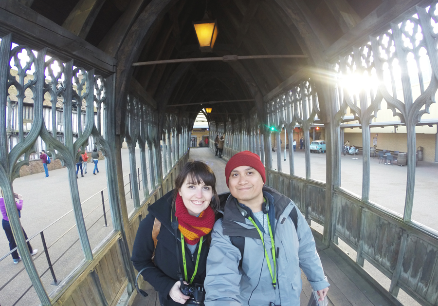 Meredith Lambert Banogon and Kevin Banogon stand on the bridge to the outer region of Hogwarts used in the Harry Potter movies.