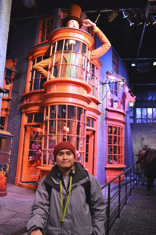 Kevin banogon stands in front of the Weasley Wizard Wheezes in Diagon Alley at the Harry Potter Leavesden Studio Tour.