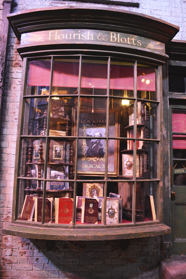 The storefront of Flourish and Blotts in Diagon Alley at the Harry Potter Leavesden Studio Tour.