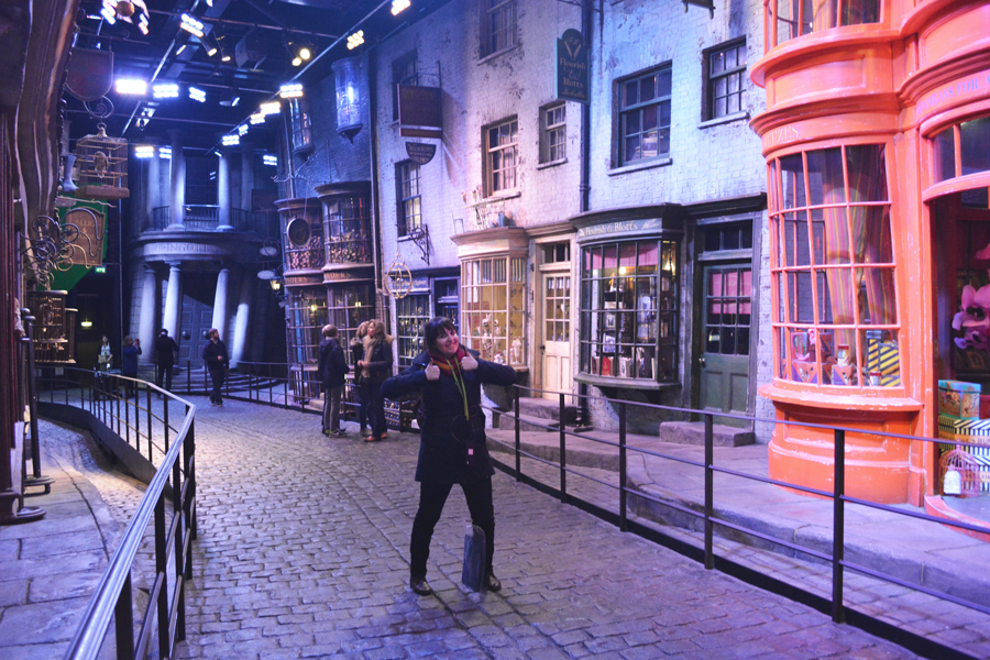 Meredith Lambert Banogon happily stands in the middle of Diagon Alley at the Harry Potter Leavesden Studio Tour.