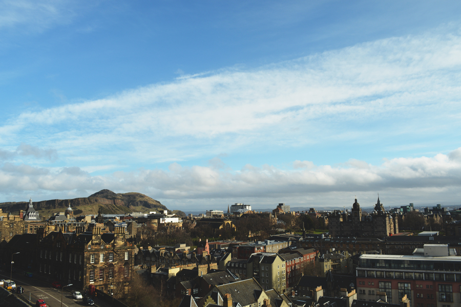 A clear sky over the city of Edinburgh as seen from the castle entrance.