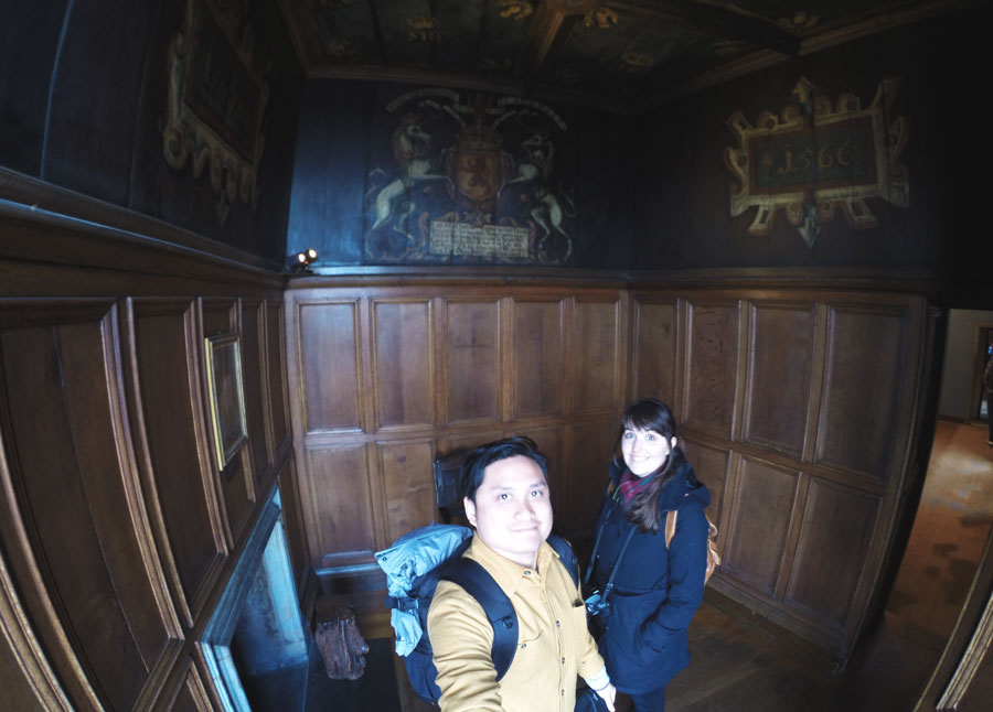 Meredith Lambert Banogon and Kevin Banogon explore tiny rooms within the Edinburgh Castle.