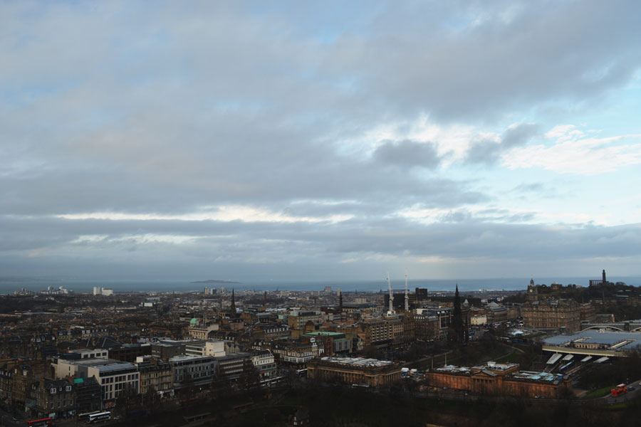 A stormy view over the city of Edinburgh as seen from the castle walls.