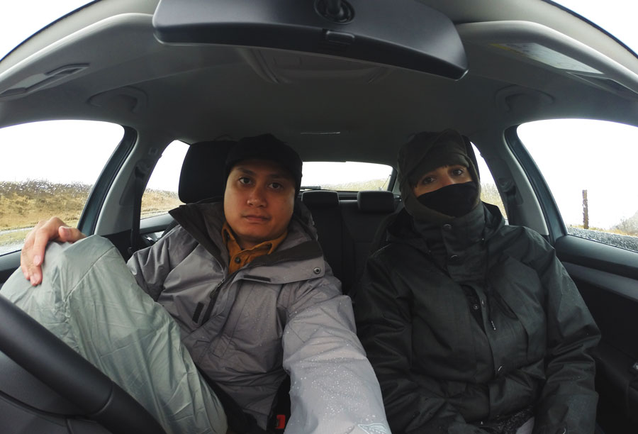 Meredith Lambert Banogon and Kevin Banogon prepare to face the elements while driving around the Isle of Skye.