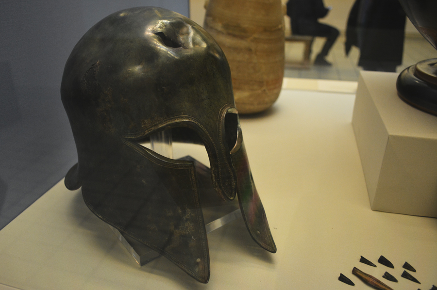 A cracked Spartan helmet on display at the British Museum tells an intense story of Greek history.