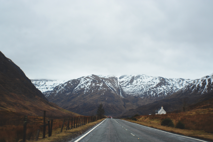 A single white home sits right off the road during a road trip to Edinburgh from the Isle of Skye.