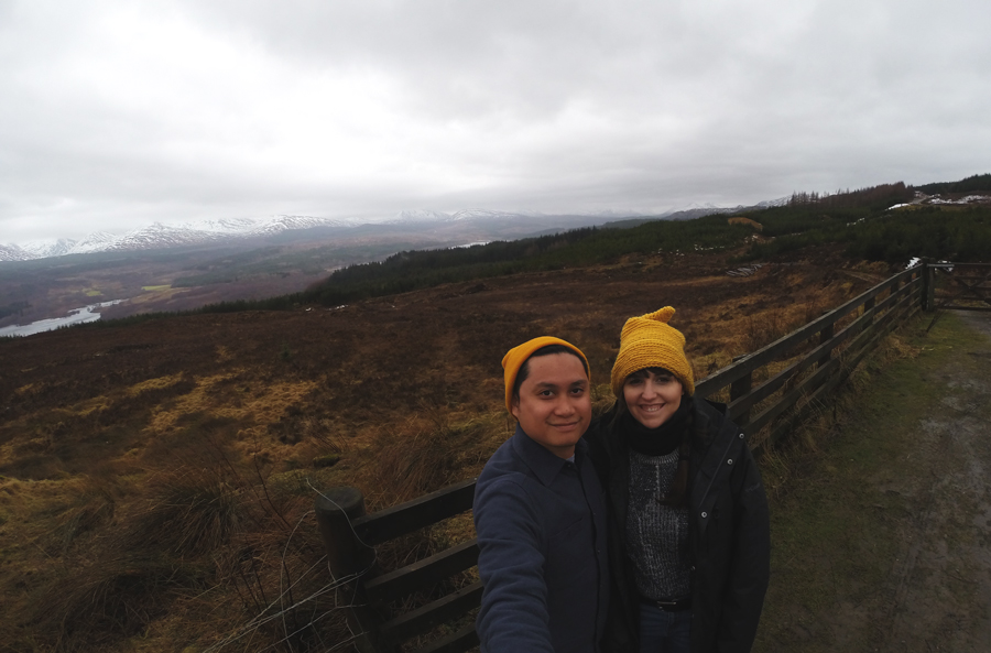 Meredith Lambert Banogon and Kevin Banogon pose in front of Scotland's landscape during their honeymoon.
