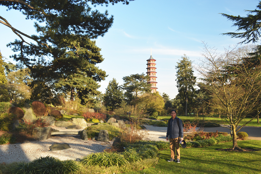 Kevin Banogon poses in front of The Great Pagoda within the Royal Botanic Gardens at Kew during his honeymoon to England.