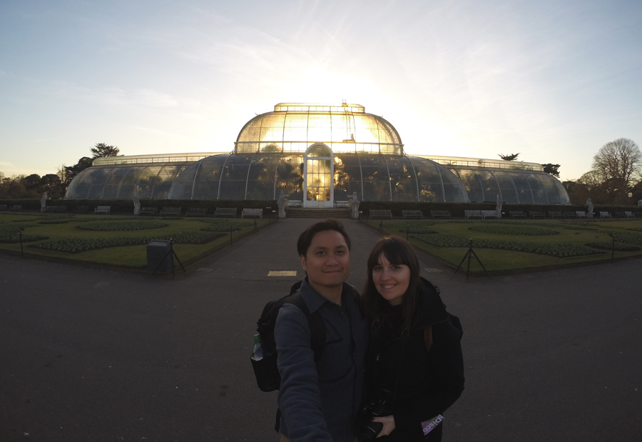 Meredith Lambert Banogon and Kevin Banogon take a photo in front of the Palm House of the Gardens at Kew a beautiful attraction during a honeymoon in England.