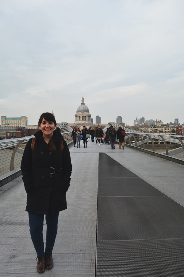 Meredith Lambert Banogon poses on the Millennium Bridge in London with St. Paul's Cathedral in the background.