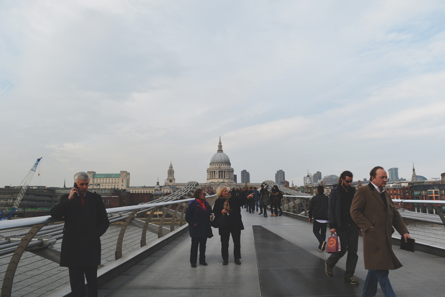 Many pedestrians cross the Millennium Bridge in order to get across the Thames River.