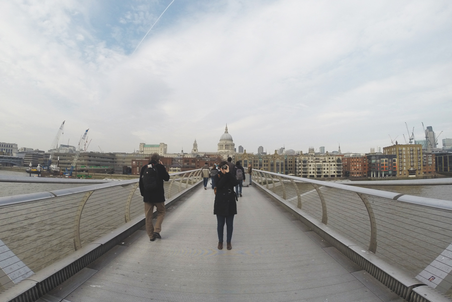 Meredith Lambert Banogon snaps a picture as she crosses the Millennium Bridge in London, England.