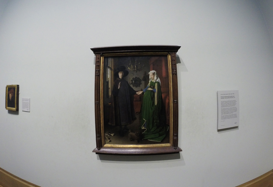 The Arnolfini Portrait within The National Gallery by Van Eyck.