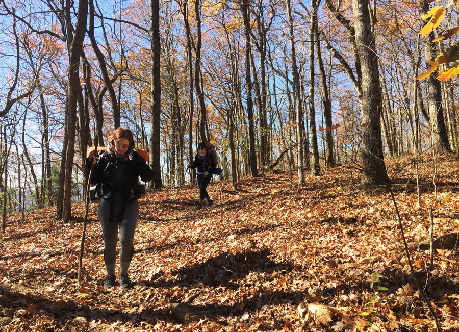 Meredith Lambert Banogon and Whitney Kics hike along the 8 mile trail to Springer Mountain.