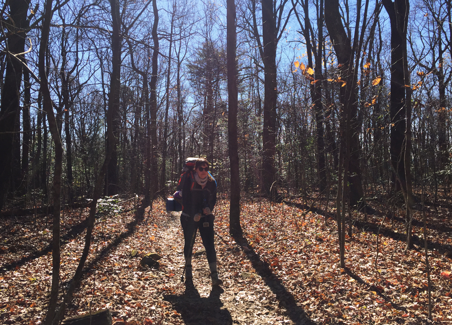 Meredith Lambert Banogon hikes through the fall light along the AT Approach Trail.