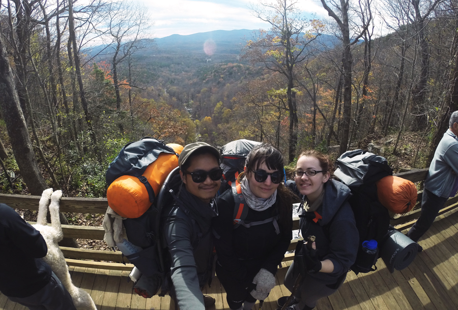 Kevin Banogon, Meredith Lambert Banogon, and Whitney Kics feel relieved as they finish the Appalachian Approach Trail to Springer Mountain.