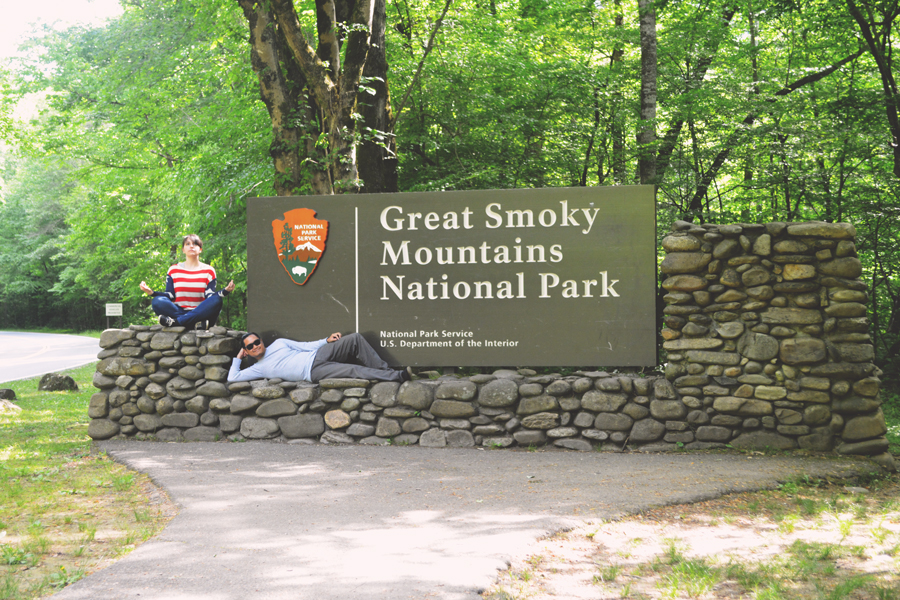Meredith Lambert Banogon and Kevin Banogon pose in front of the southern entrance sign of the Great Smoky Mountains National Park during their weekend trip out of Atlanta.