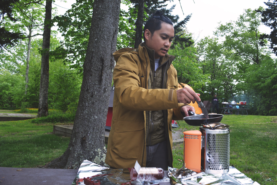 Kevin Banogon cooks breakfast on his BioLite Stove at the Balsam Mountain Campground during a weekend out of the city.