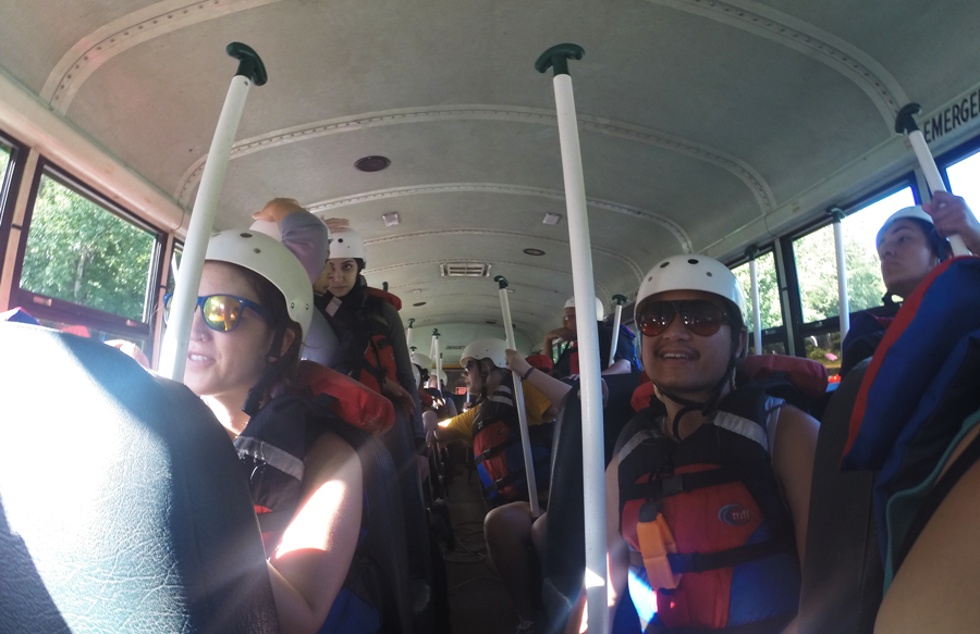 Kevin Banogon and Zoe Gordon ride the bus to the launch point for their whitewater rafting adventure in Chattanooga, Tennessee.