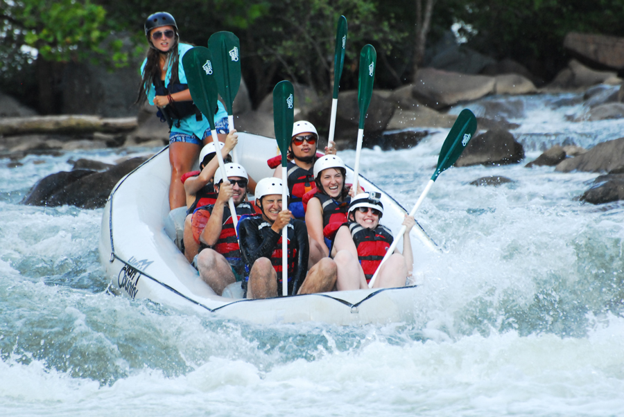 During larger drops in the Ocoee River, whitewater rafters get inside the boat to ride it out.