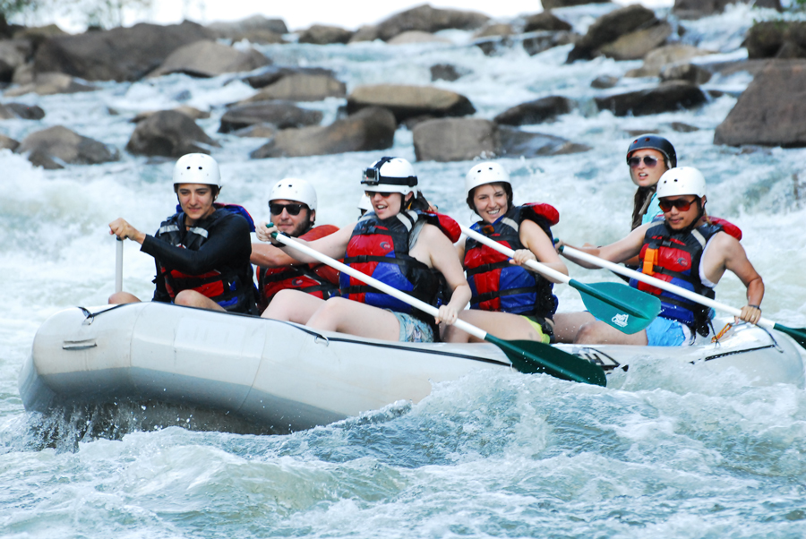 Tour groups paddle hard when the raft guide tells them to as they head down the Ocoee River outside of Chattanooga, Tennessee.
